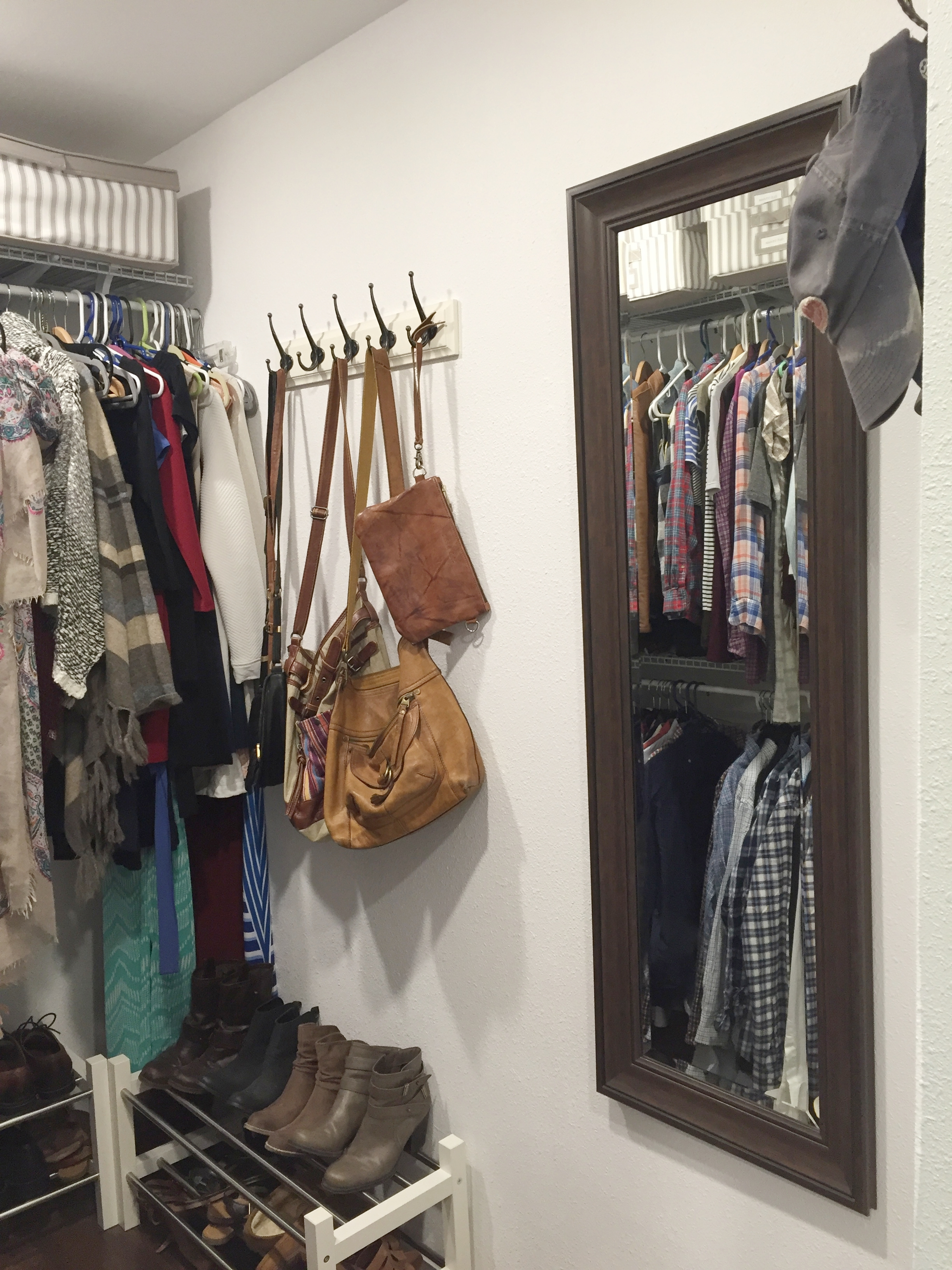 Large walk in closet with mirror.