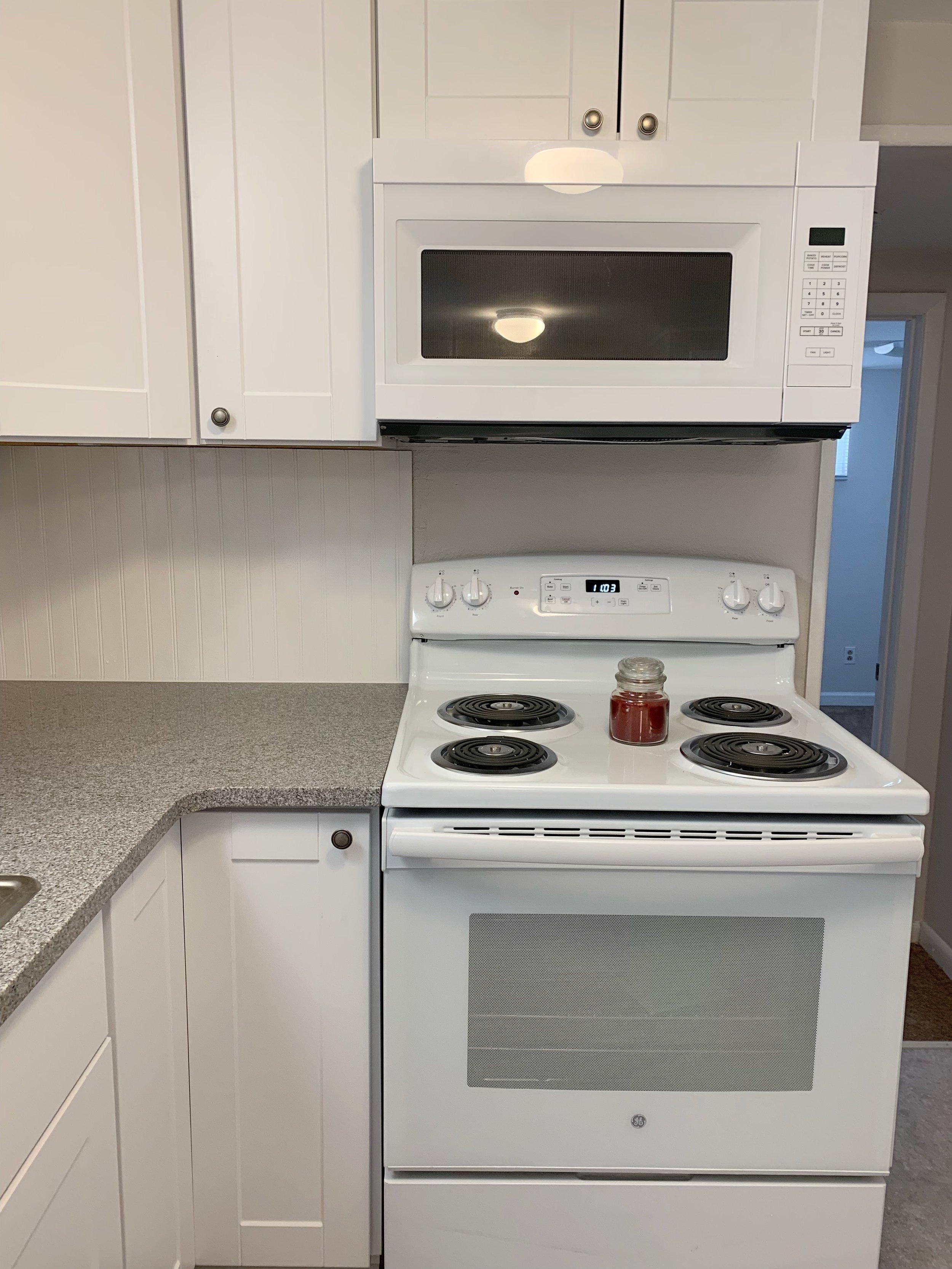 New appliances, granite countertops and DIY bead board backsplash