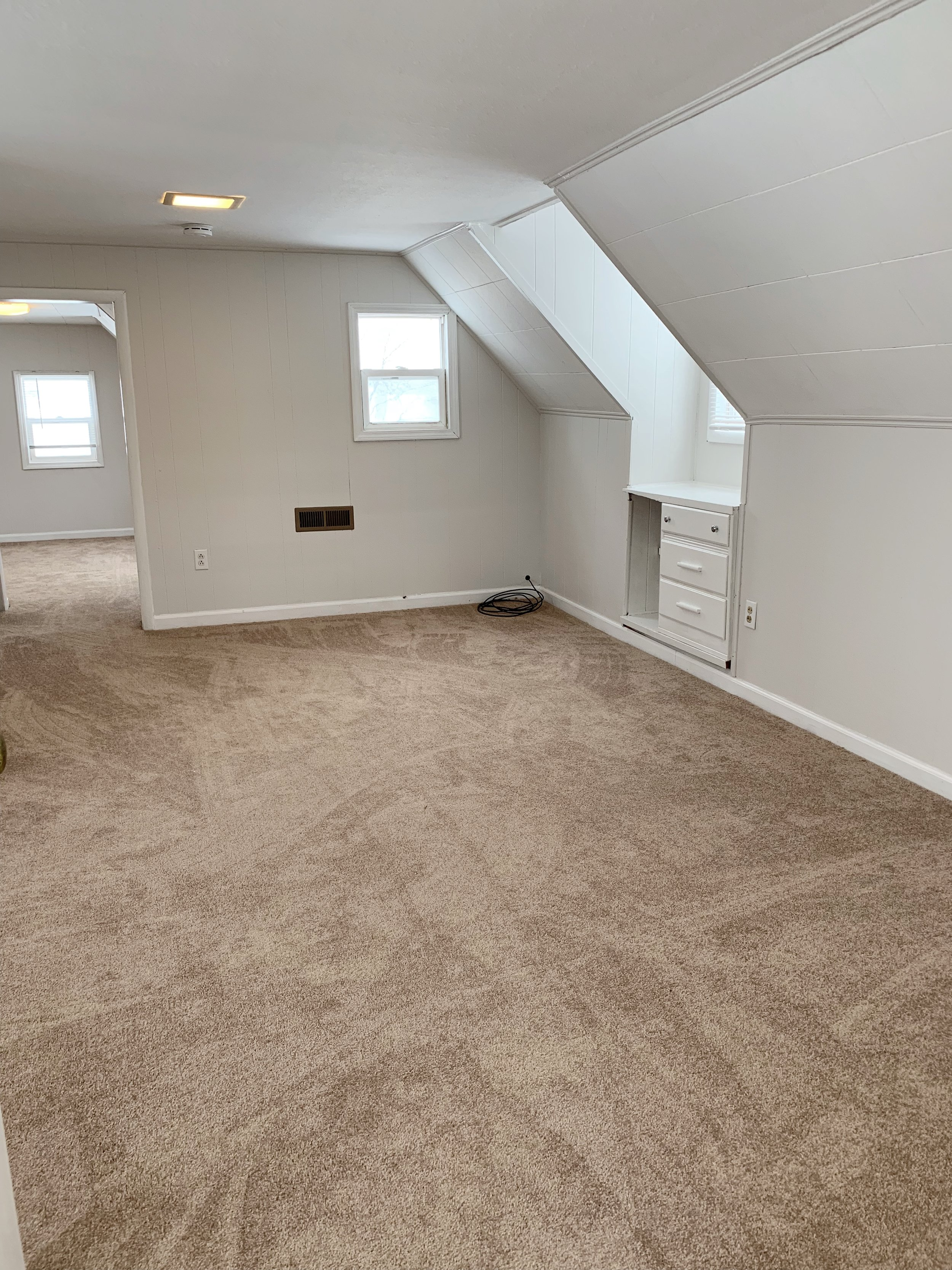 Large upstairs bedroom with bonus room