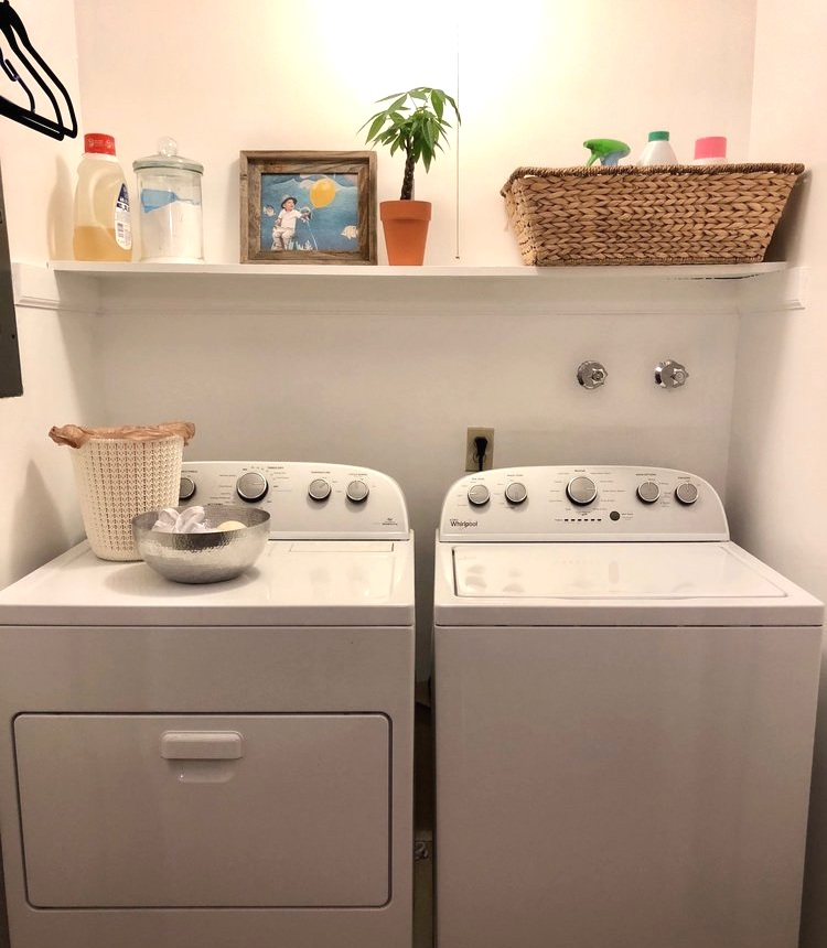 The laundry room closet after paint and decluttering