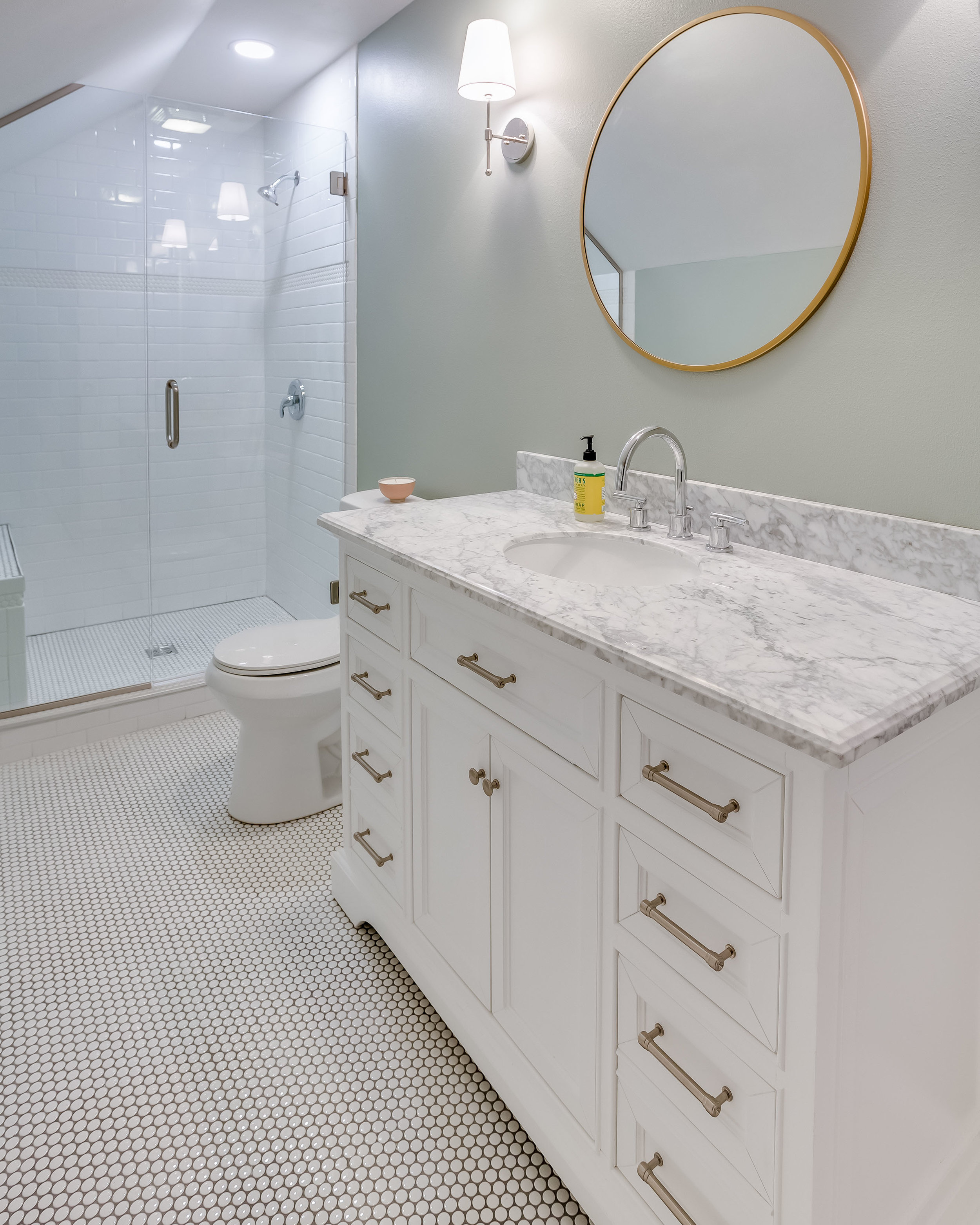 After, the bathroom has an improved layout with a walk in shower and stylish features.