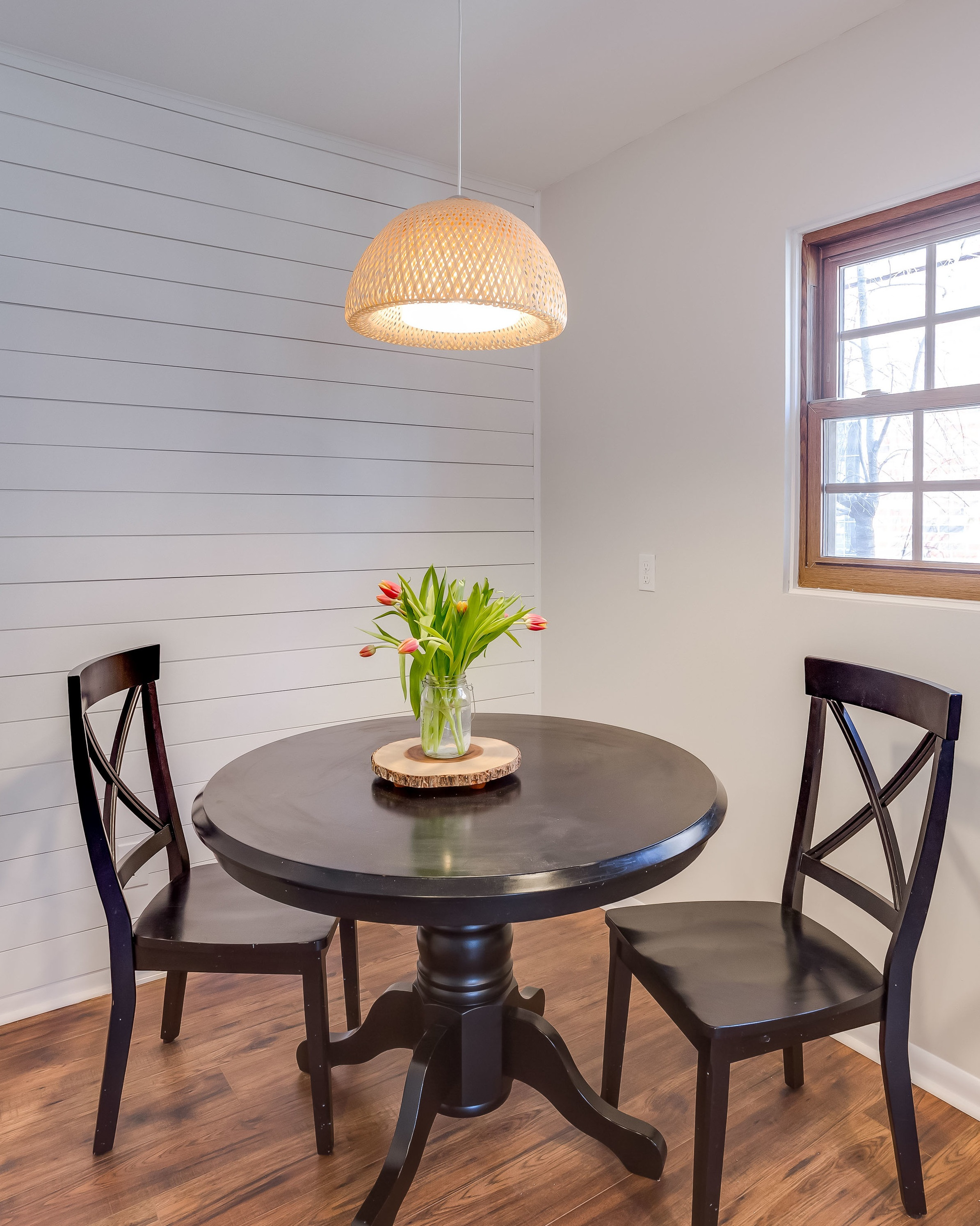 After the kitchen was removed, a perfect breakfast nook was created with a shiplap accent wall.