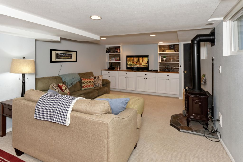 The basement playroom after we painted the walls a cool blue and added built in cabinets and book shelves.