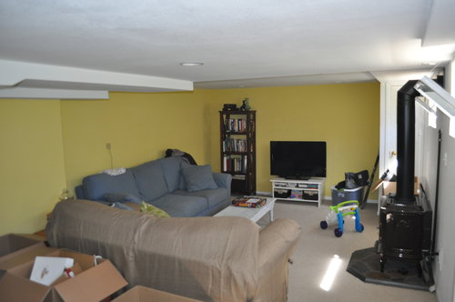 The basement had a bright yellow paint color on the walls that we wanted to change. The basement also came with an awesome electric fireplace.