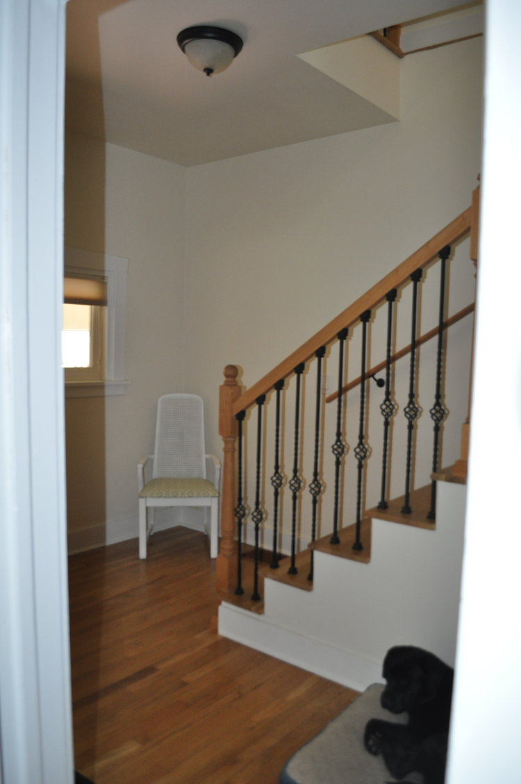 The back hallway used to be a bedroom before the second story was added to this home so it is very spacious even with the back stairwell.
