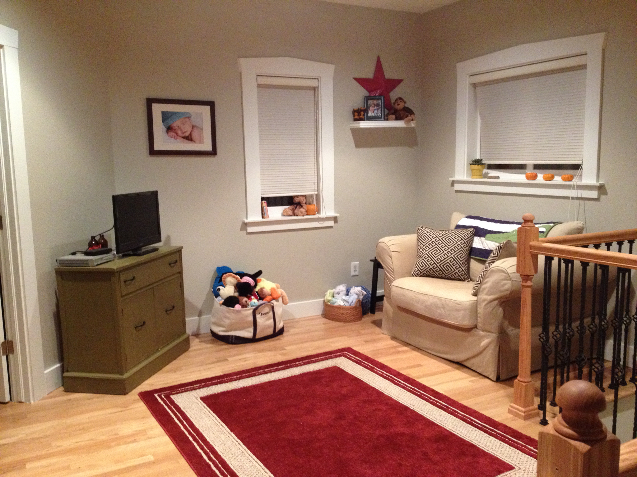 The upstairs landing with the new paint color Revere Pewter. We used it as a playroom while living in the home.