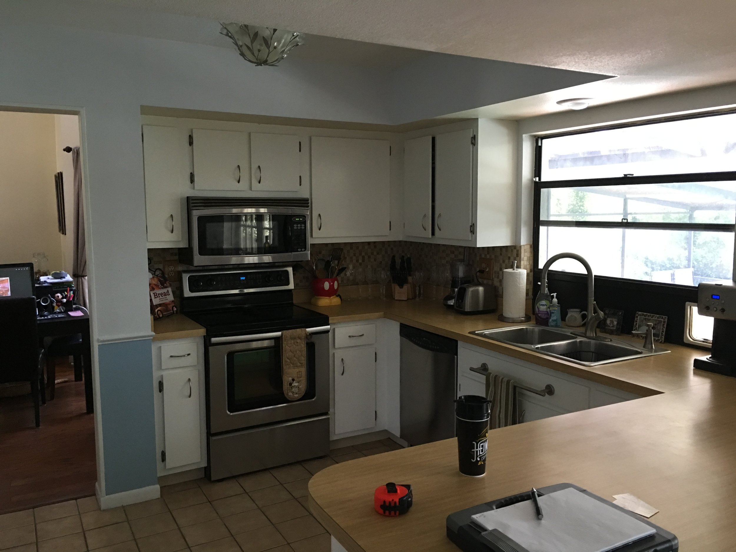 Before: Dated kitchen with updated appliances