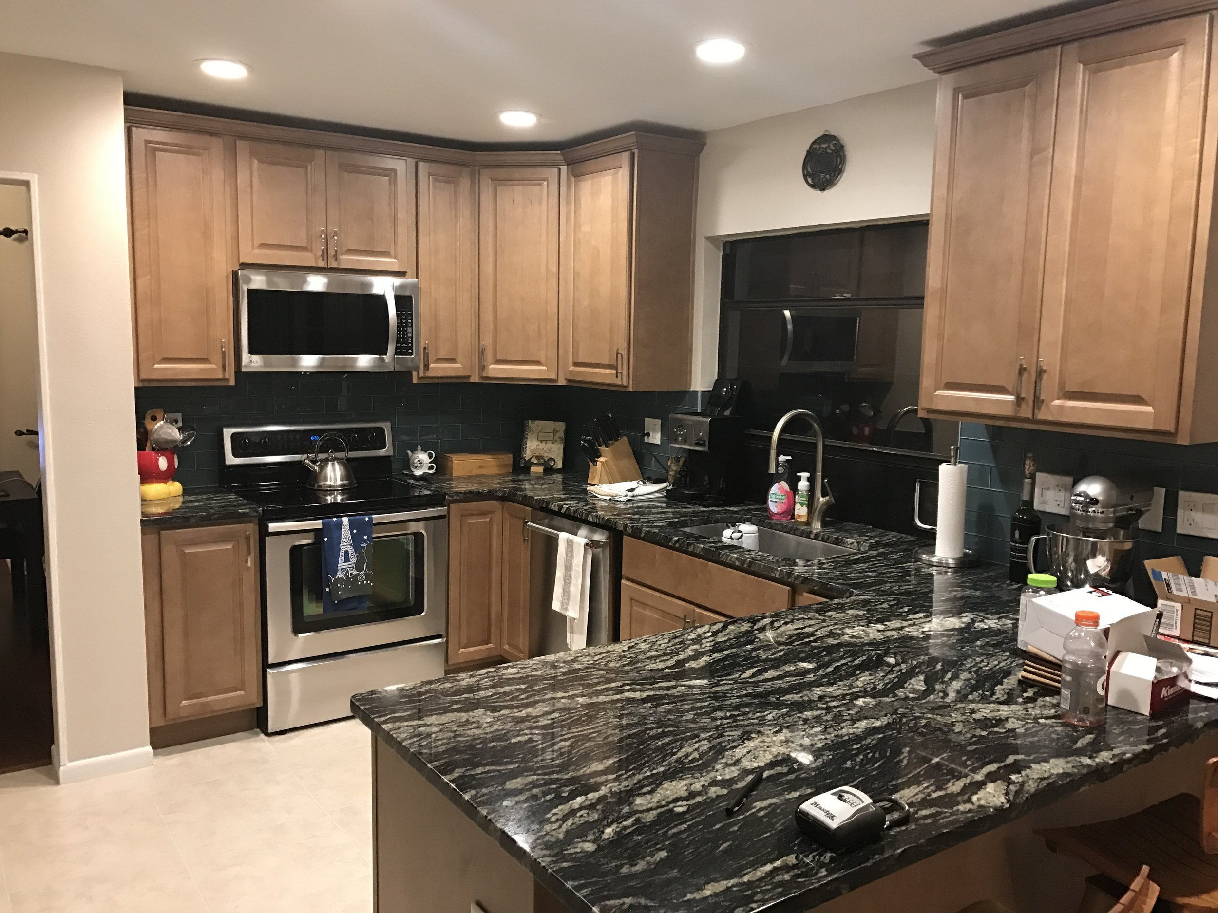 After: Maintained original layout, updated with new cabinets & countertops