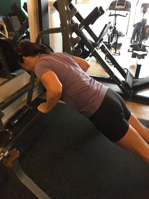 Hands elevated push-ups have allowed Brenda to build upper body and core strength.