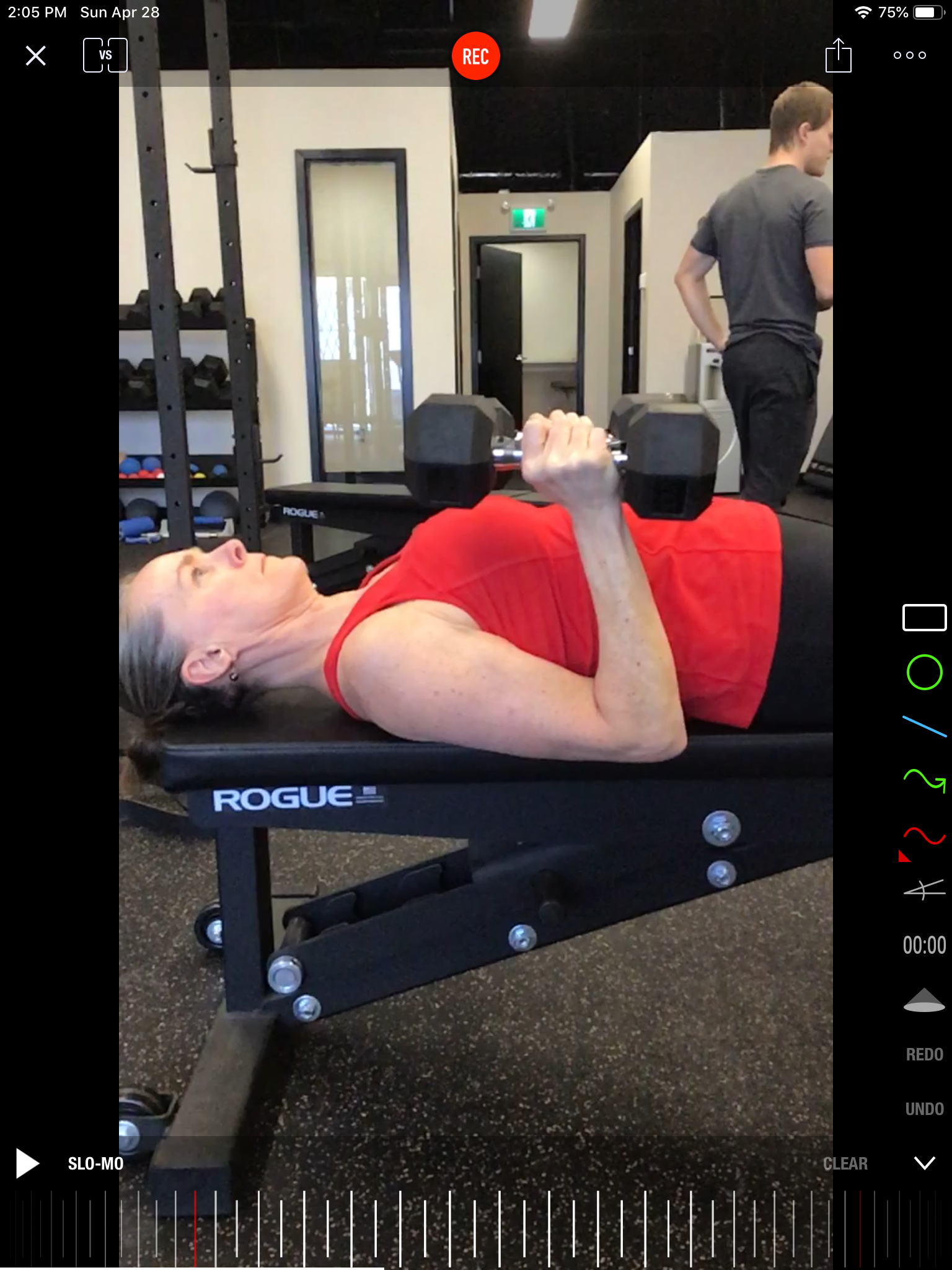 Nicolette focuses her attention during a dumbbell bench press. One of her top goals was to improve upper body strength.