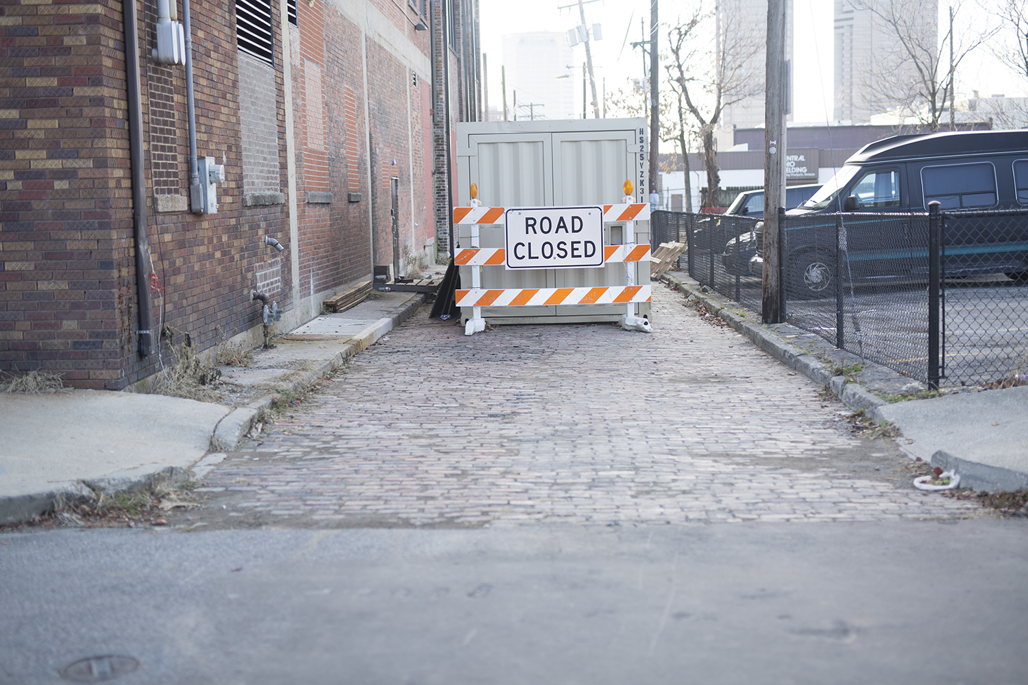 road closed sign in an alley way