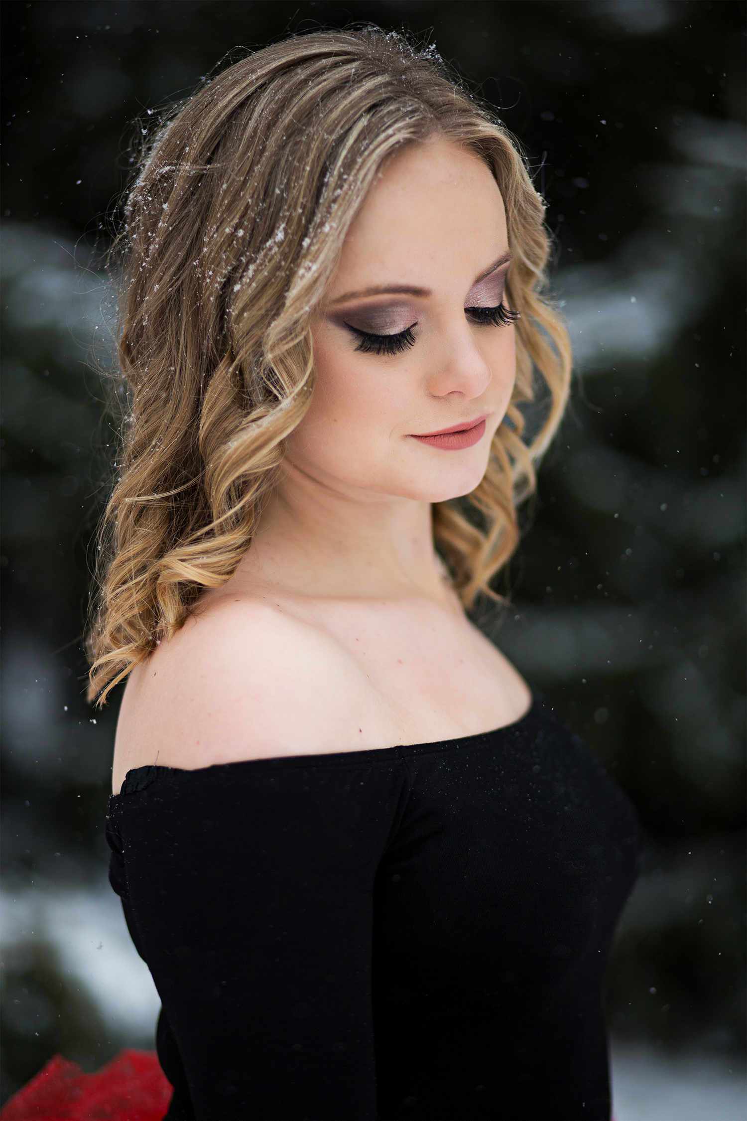 a girl looking down showing off her eye makeup.