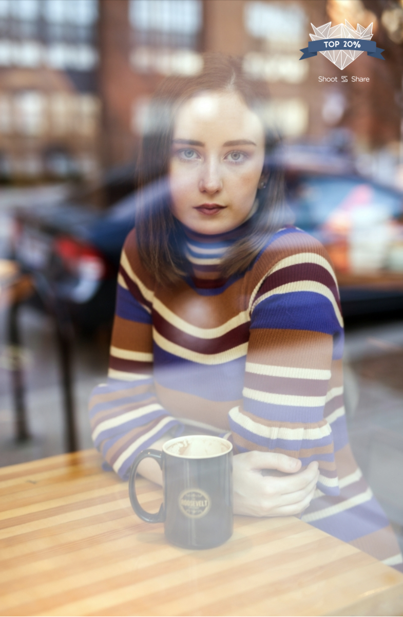 girl photographed through the window of a coffee shop in Columbus, Ohio.