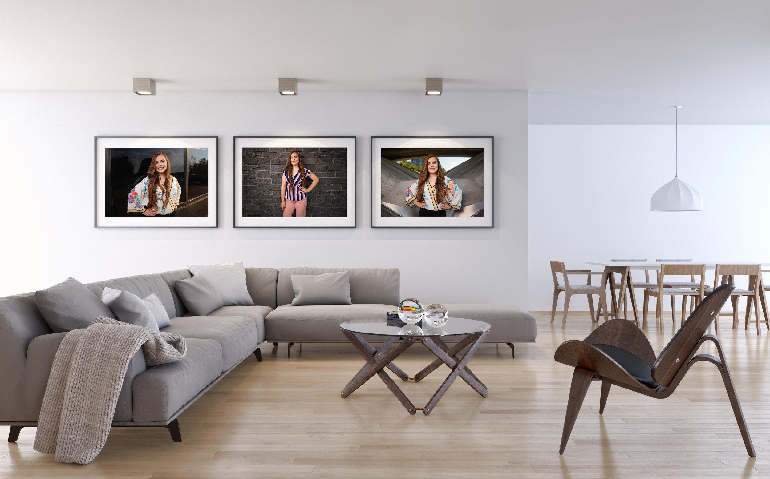 framed senior prictures on living room wall.jpg