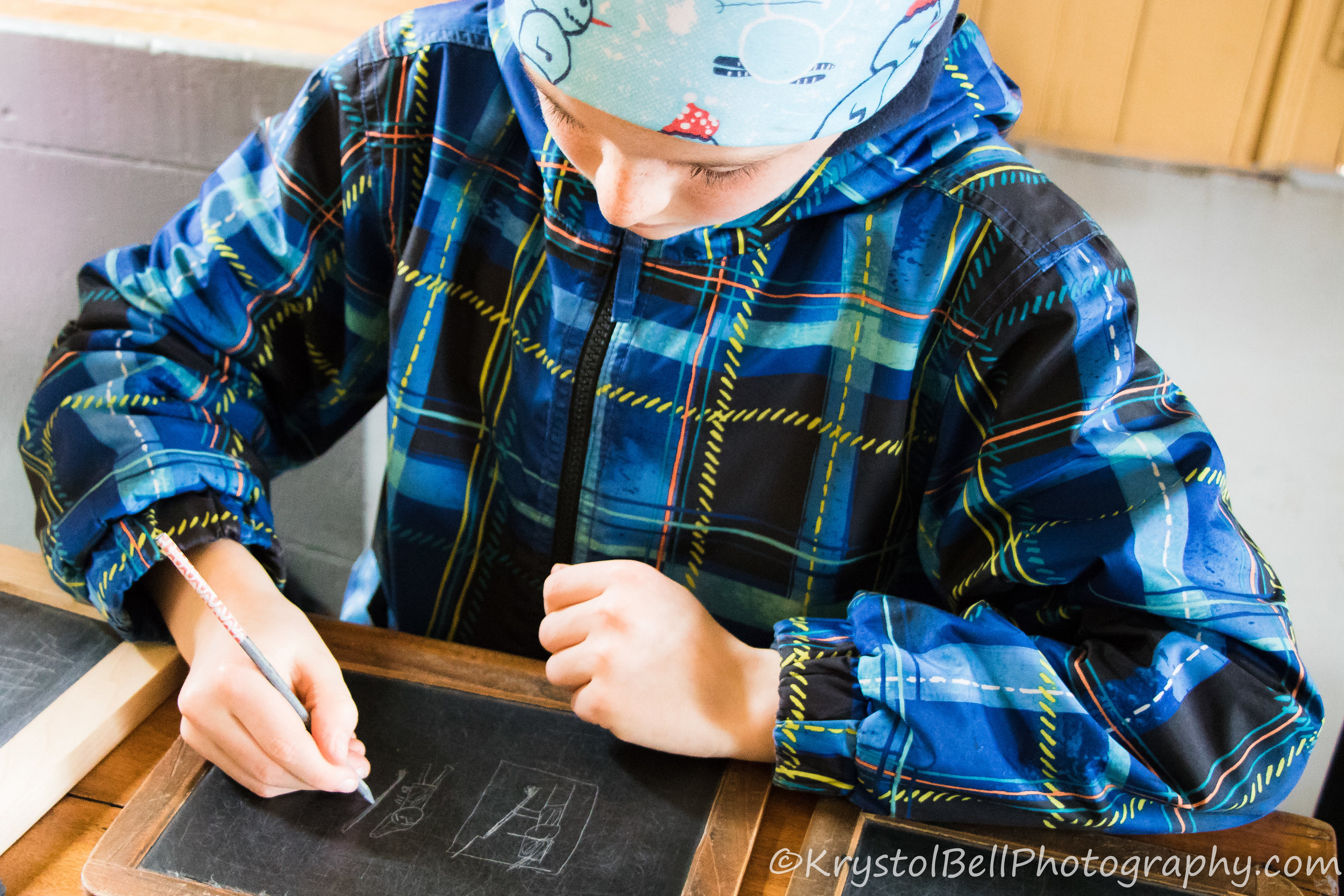 Samuel drawing a scene from the Revolutionary War-I was seriously impressed with his knowledge and drawing on a slate abilities!