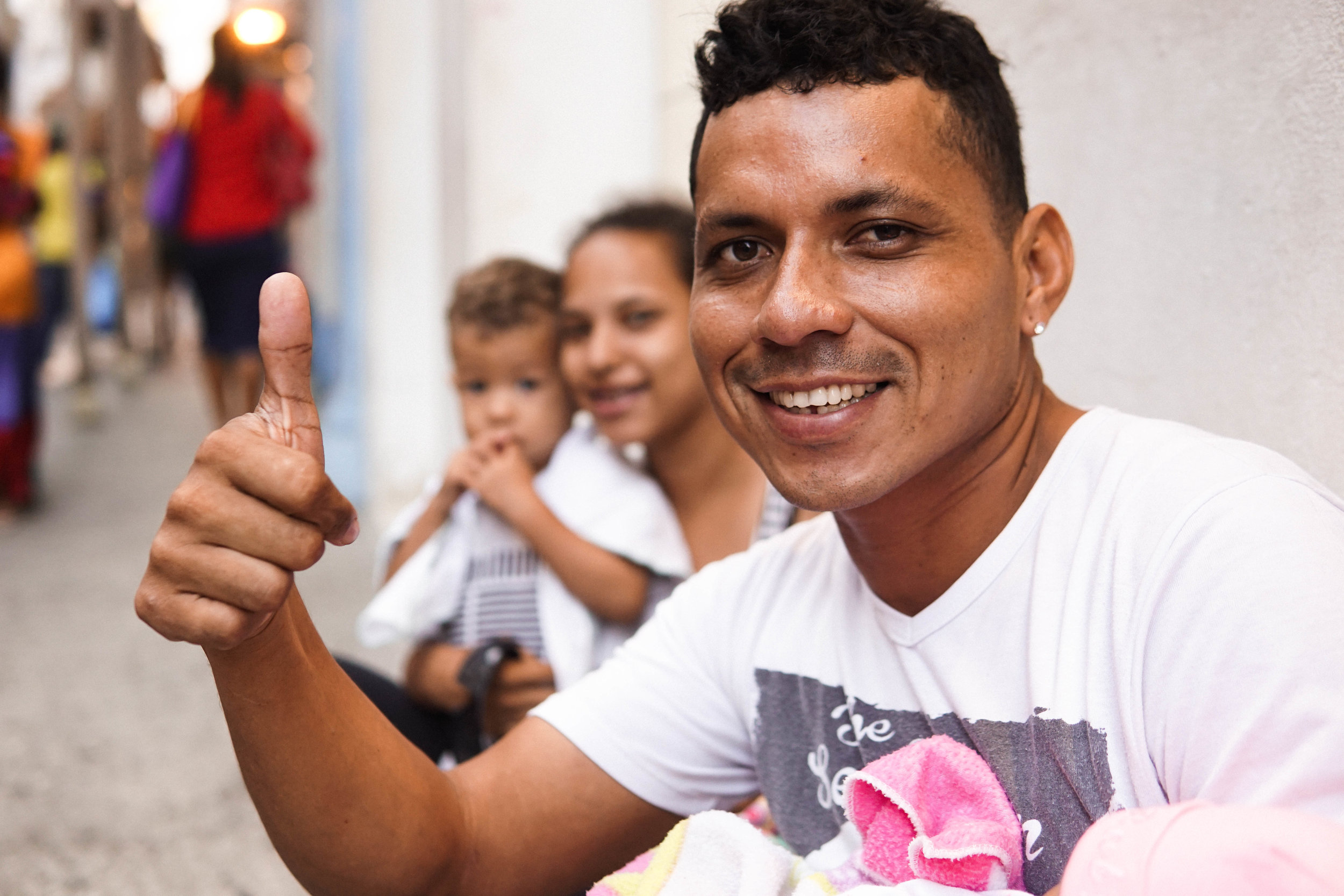 Crisis in Venezuala - Please keep immigrants from Venezuala, like pictured here in your thoughts and prayers. Their families are all over the streets of Colombia. They hope to build a new life here as Colombian immigration welcomes their arrival.