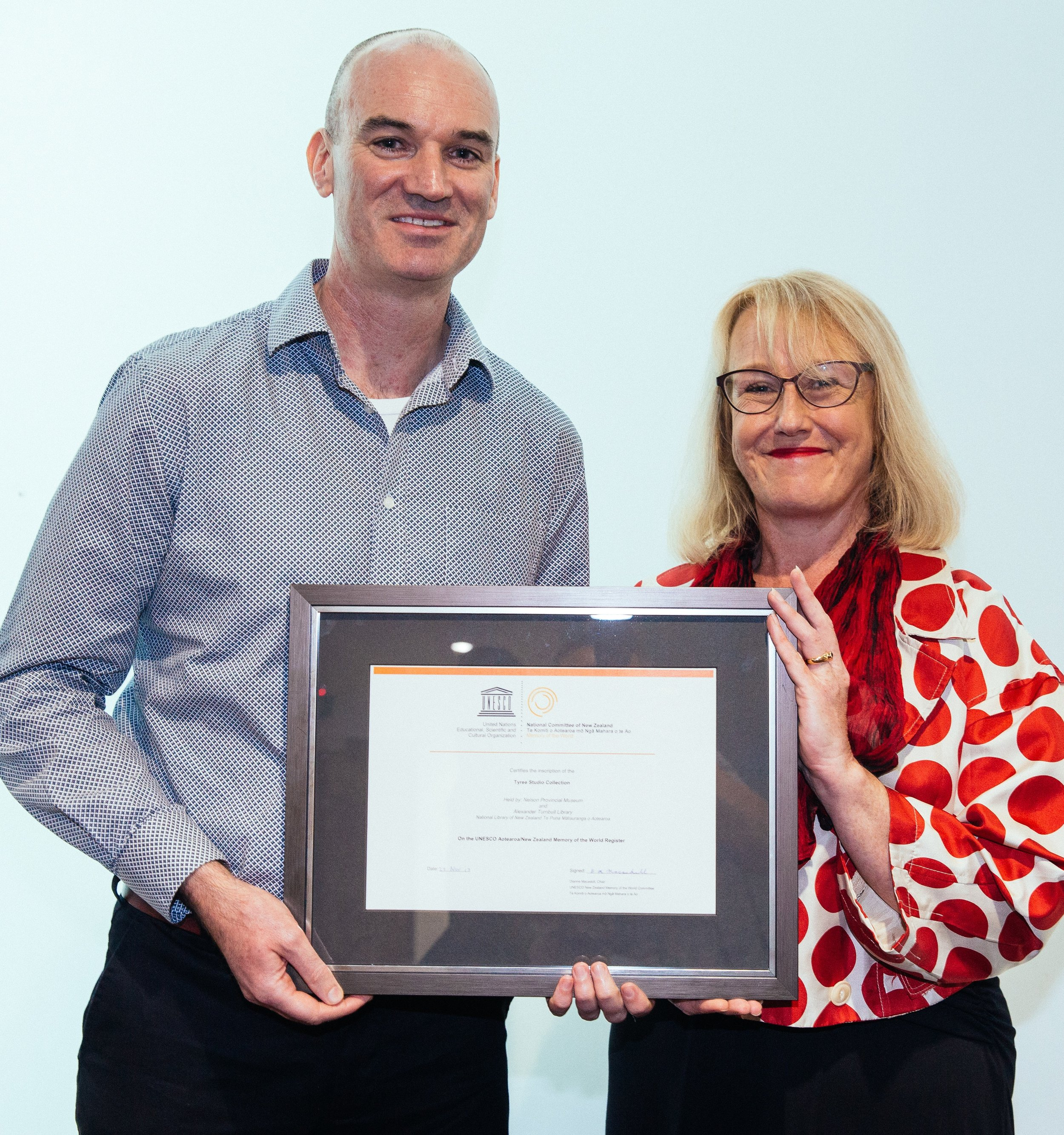 nelson provincial museum staff , Darryl gallagher - senior curator of photography and lucinda blackley-jimson - chief executive, with the unessco inscription
