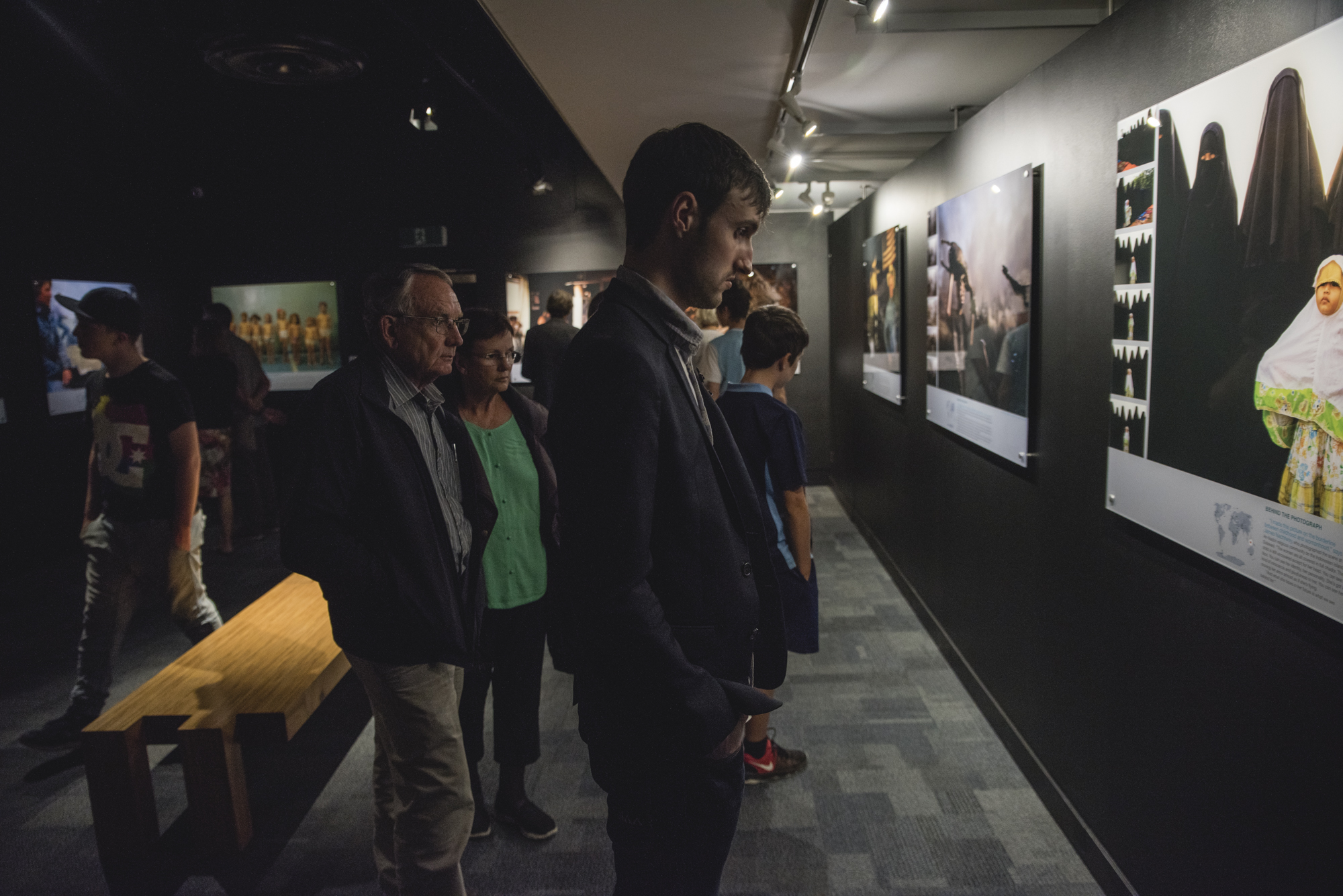 VISITORS TO THE NATIONAL GEOGRAPHIC PHOTOGRAPHIC EXHIBITION