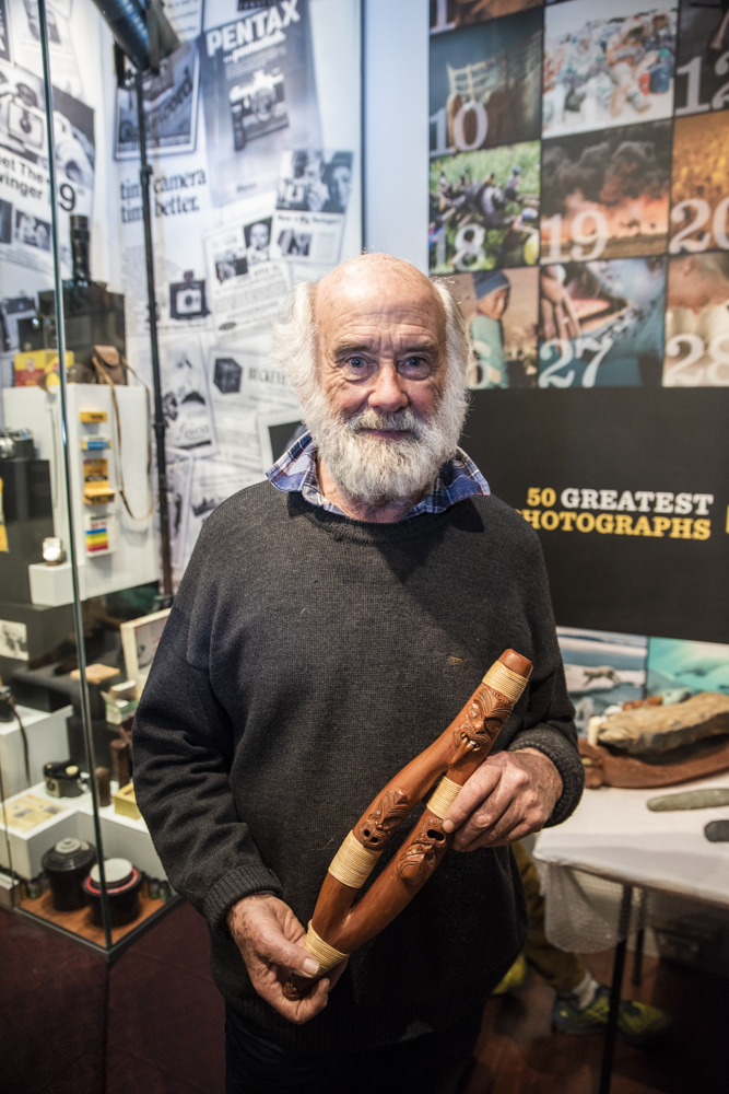 Brian Flintoff with taonga puoro from the museum's collection