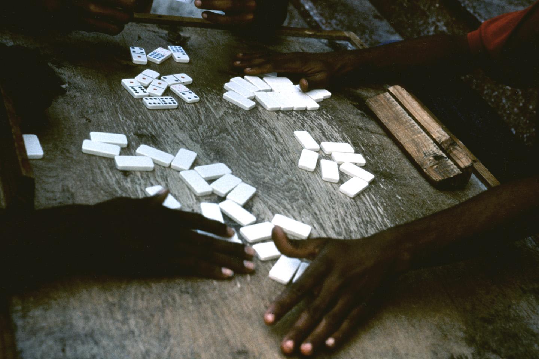 Playing dominoes, Old Havana, Cuba.
