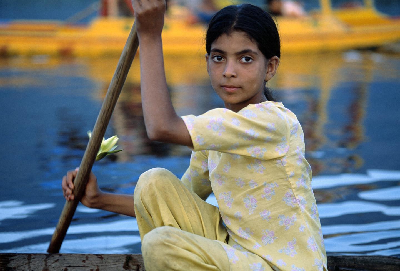 A young girl in a shikara. Dal Lake, Kashmir.