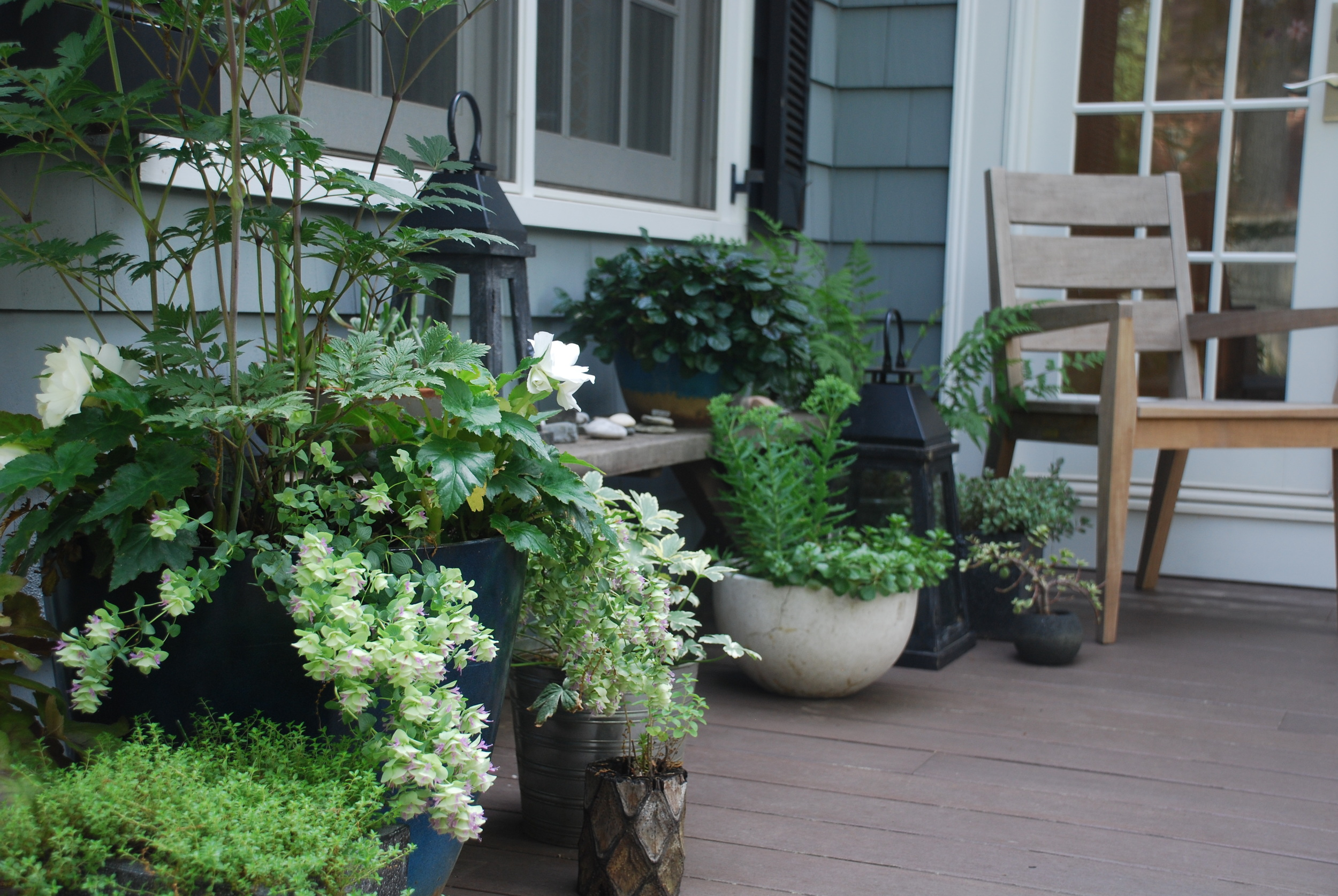Collection of containers decorating the corner of a deck