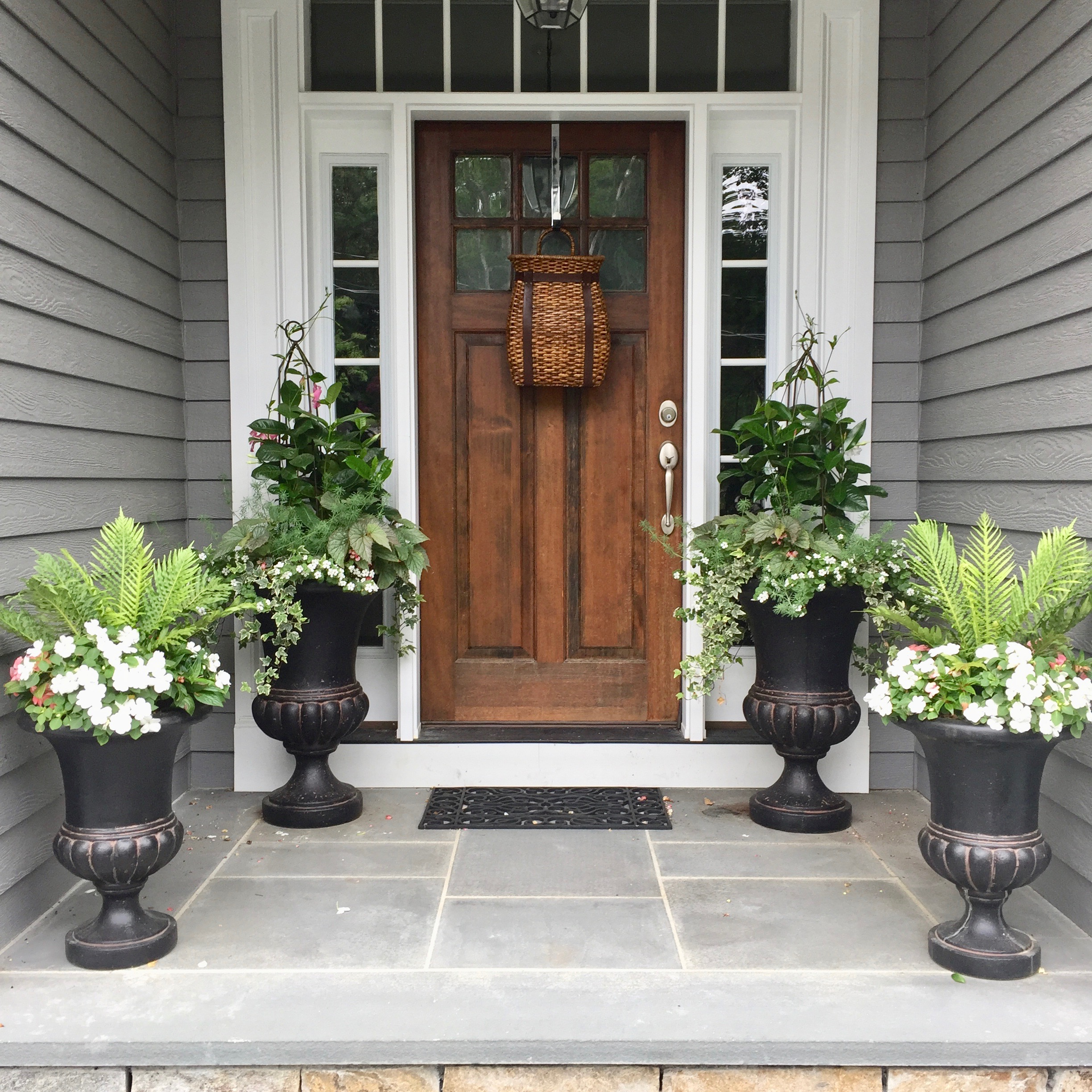 Entryway flanked by containers.