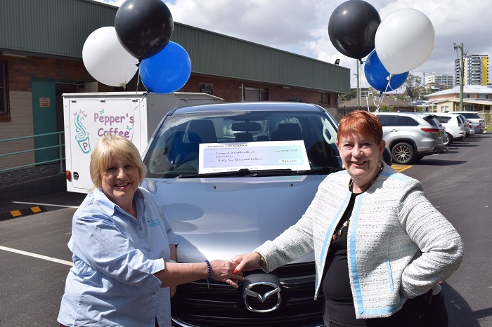 Mayor Wendy Waller (right) and Liverpool Neighbourhood Connections CEO Pat Hall celebrate the delivery of a new ute.