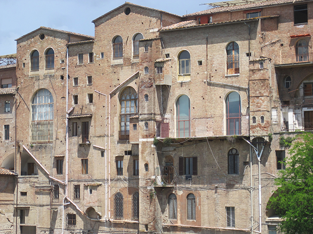 Sheer brick walls where Siena meets the surrounding countryside