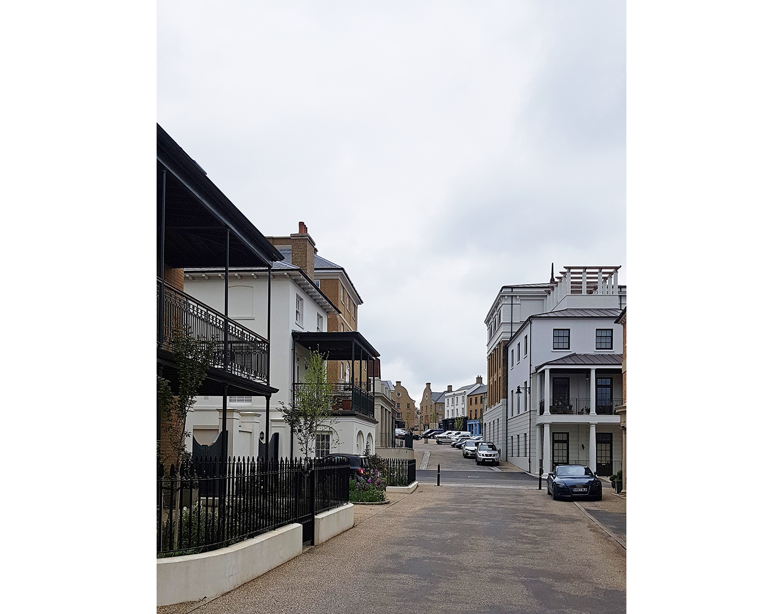Poundbury-Dorset-Architect-housing-vernacular-georgian-balcony-veranda-street.jpg