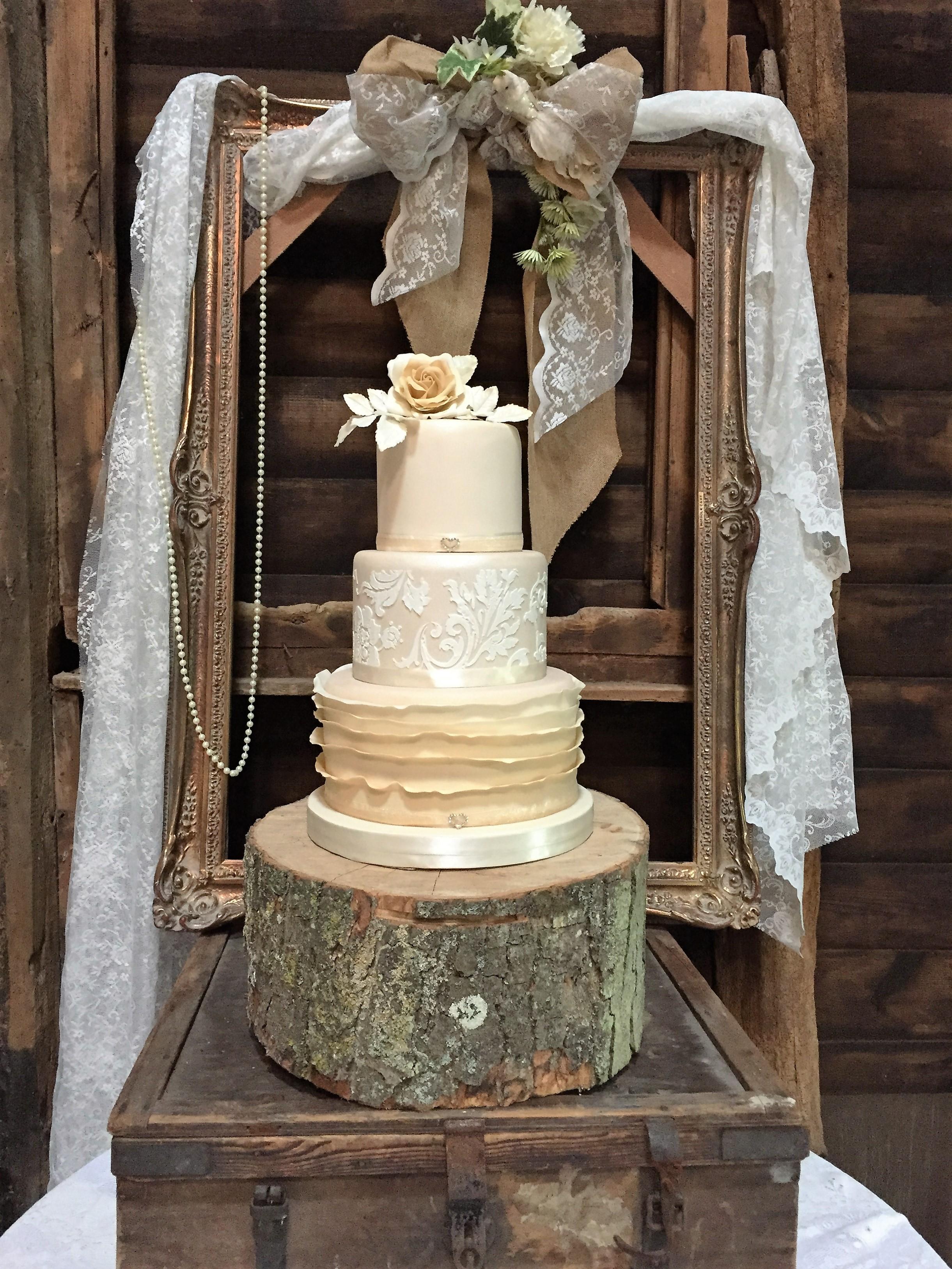 rustic wedding cake - tree stumps, lace and hessian.JPG