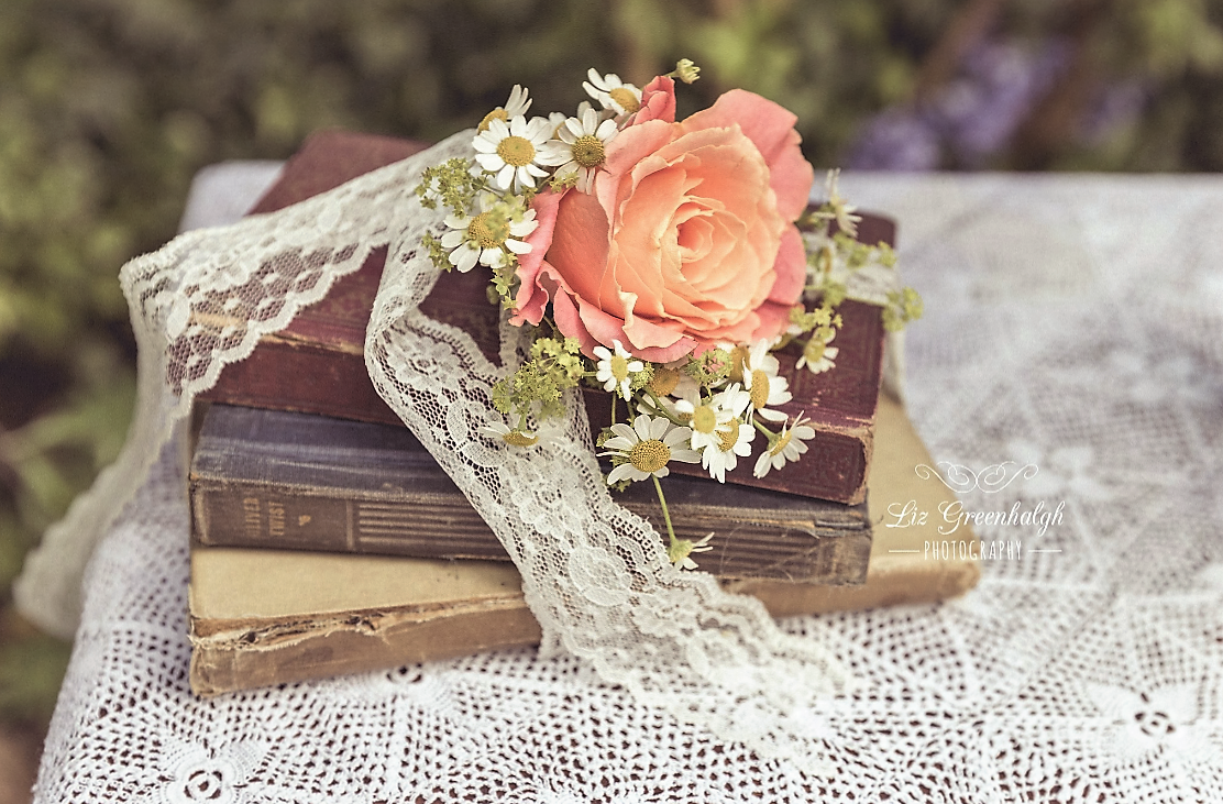 Vintage books wrapped in lace.PNG