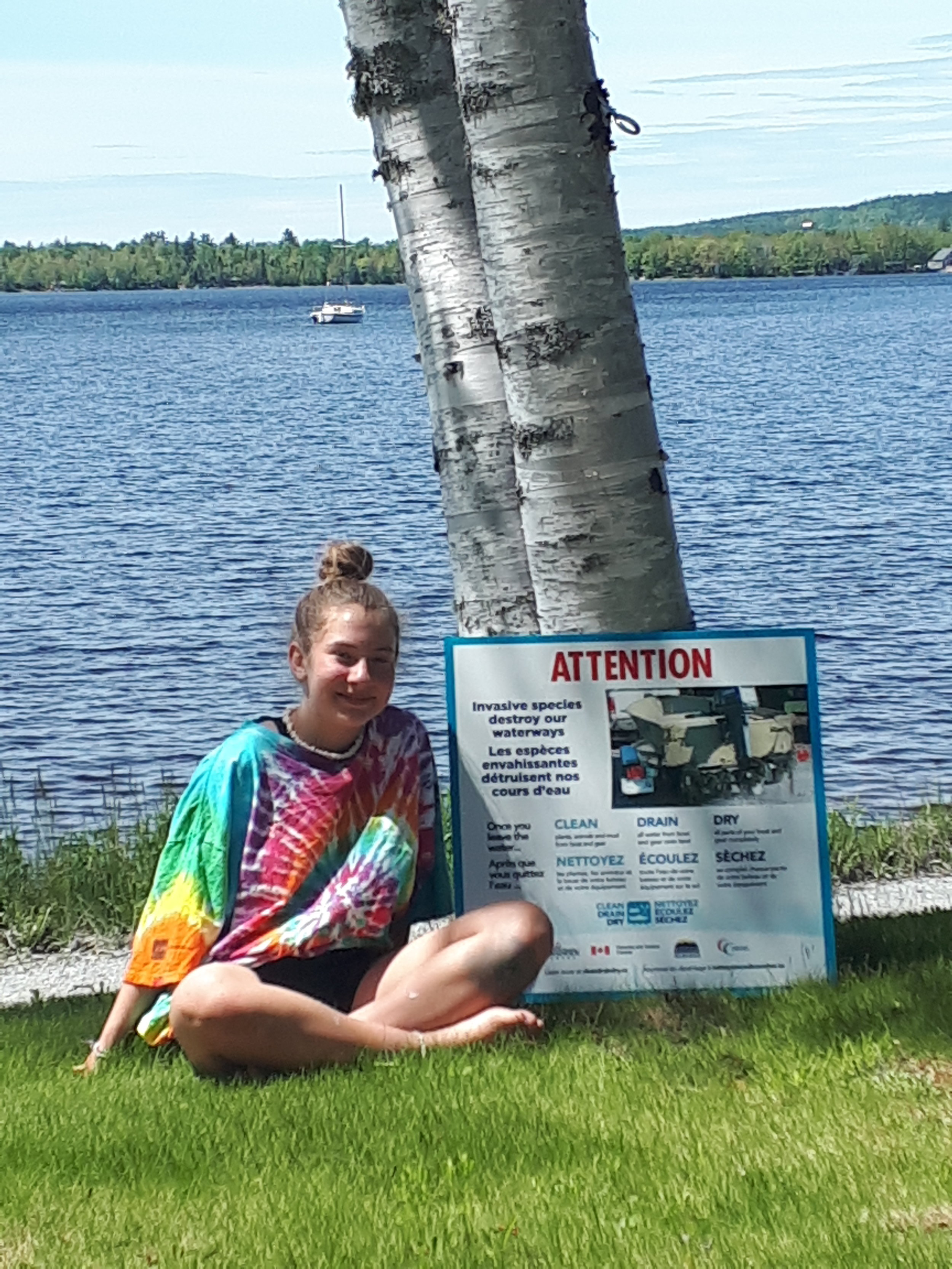 Molly Cook, NBALA Youth Ambassador of 2019 outside Lake George with a CDD sign