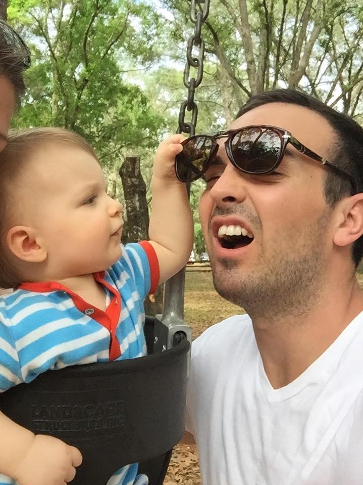 son grabbing dads sunglasses