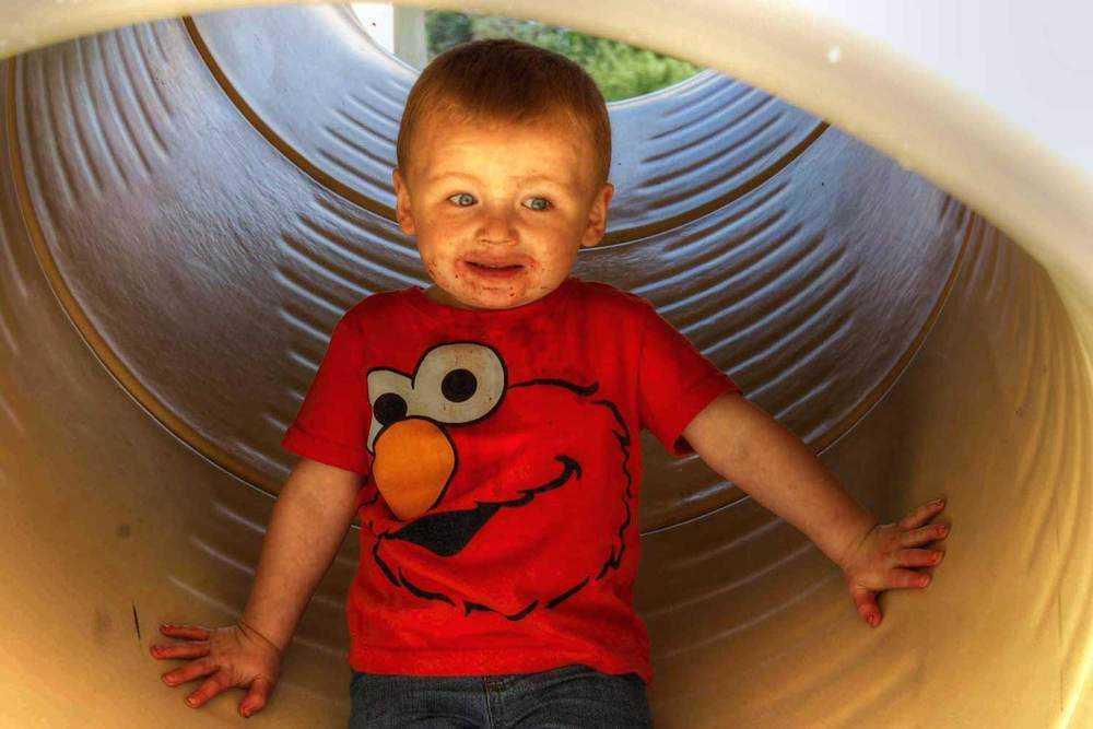 young child afraid of slide