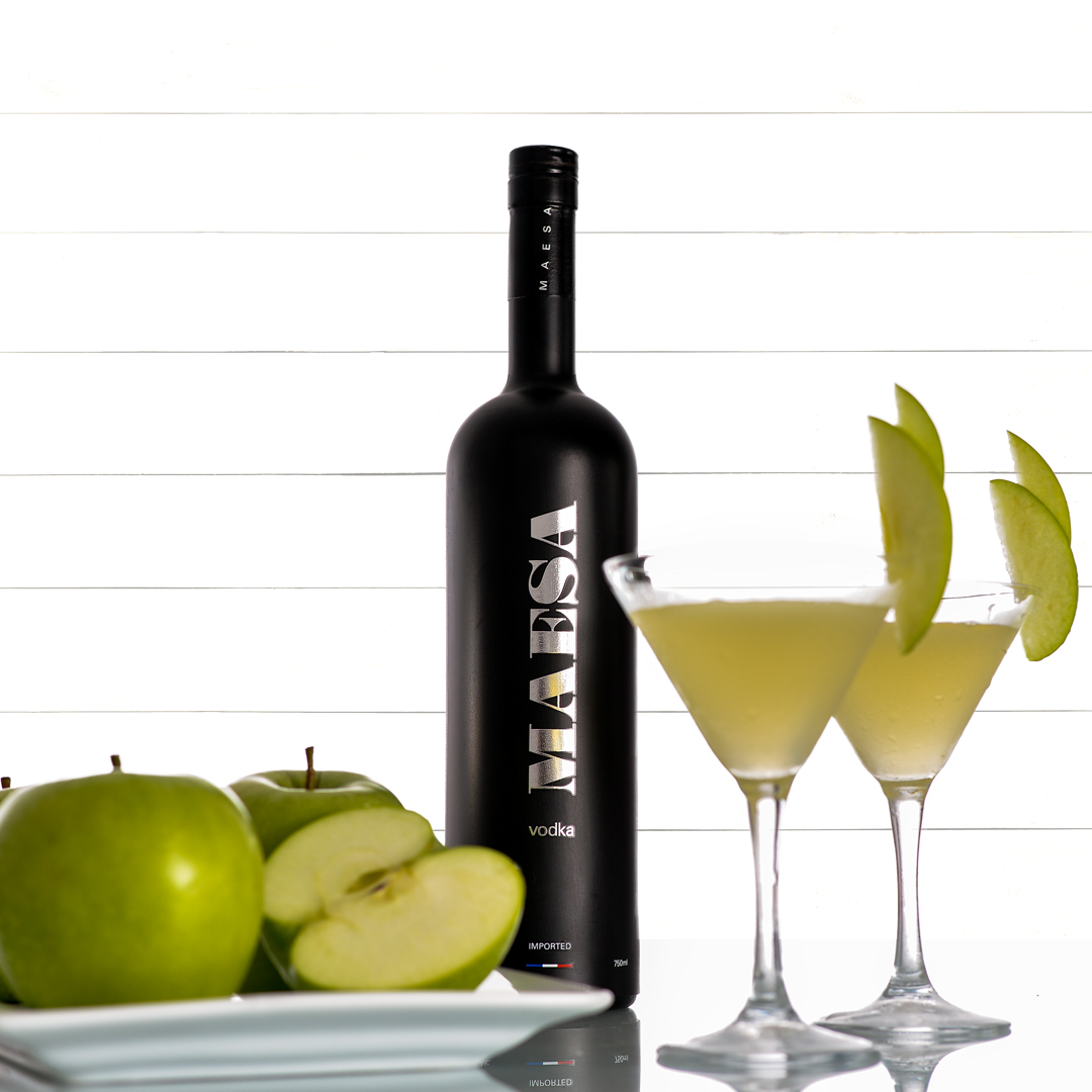 Apple martini - Fill a cocktail shaker with ice and add1 oz MAESA Vodka1/3 oz simple syrup1/3 oz lemon juice2/3 oz fresh apple juice2/3 oz apple liquorShake well and strain into chilled martini glassComplement with apple slices