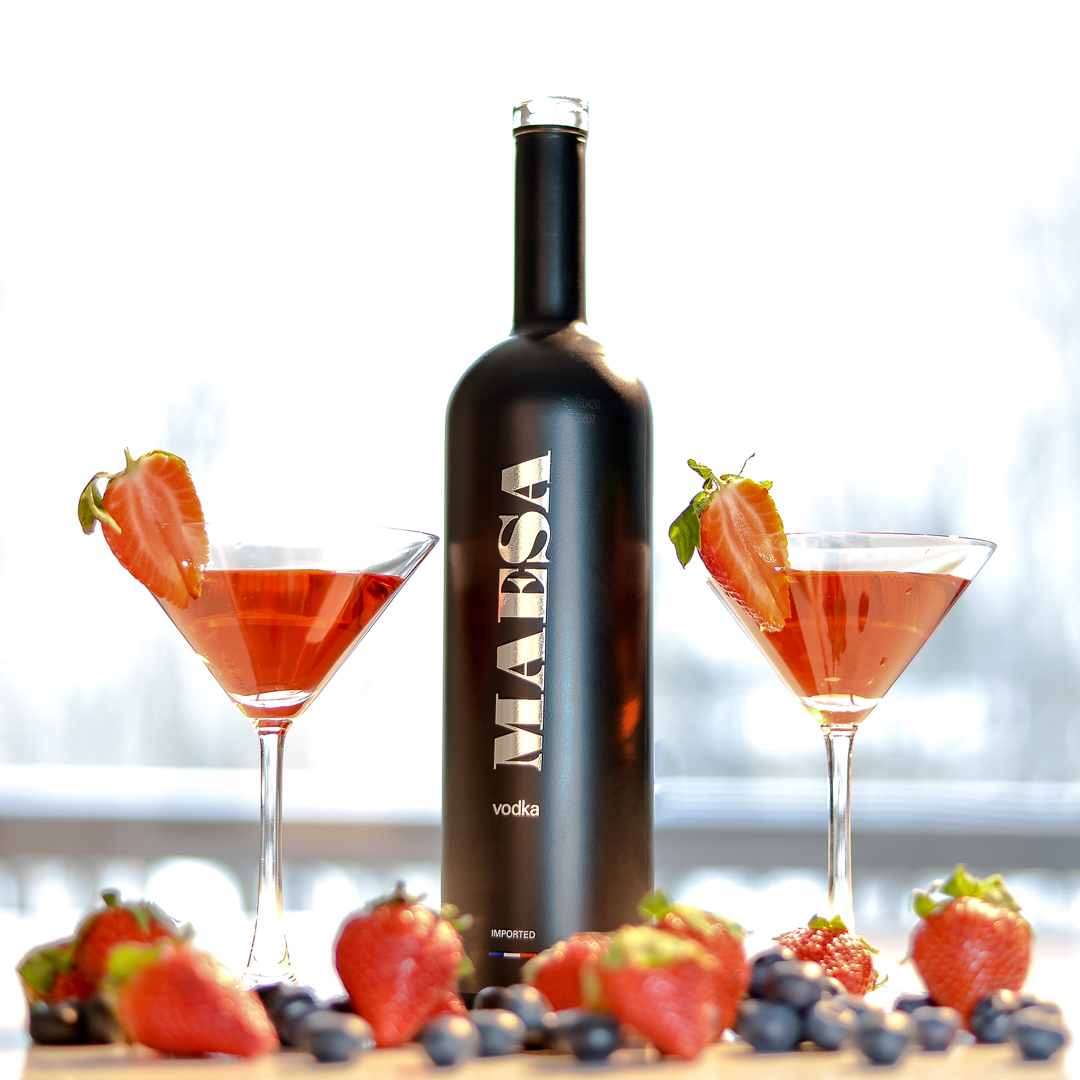 MAESA berrytini - Fill a cocktail shaker with ice and add1 1/2 oz MAESA Vodka1/3 oz strawberry liquor1/3 oz blueberry juice1/2 oz orange liquorShake well and strain into martini glass