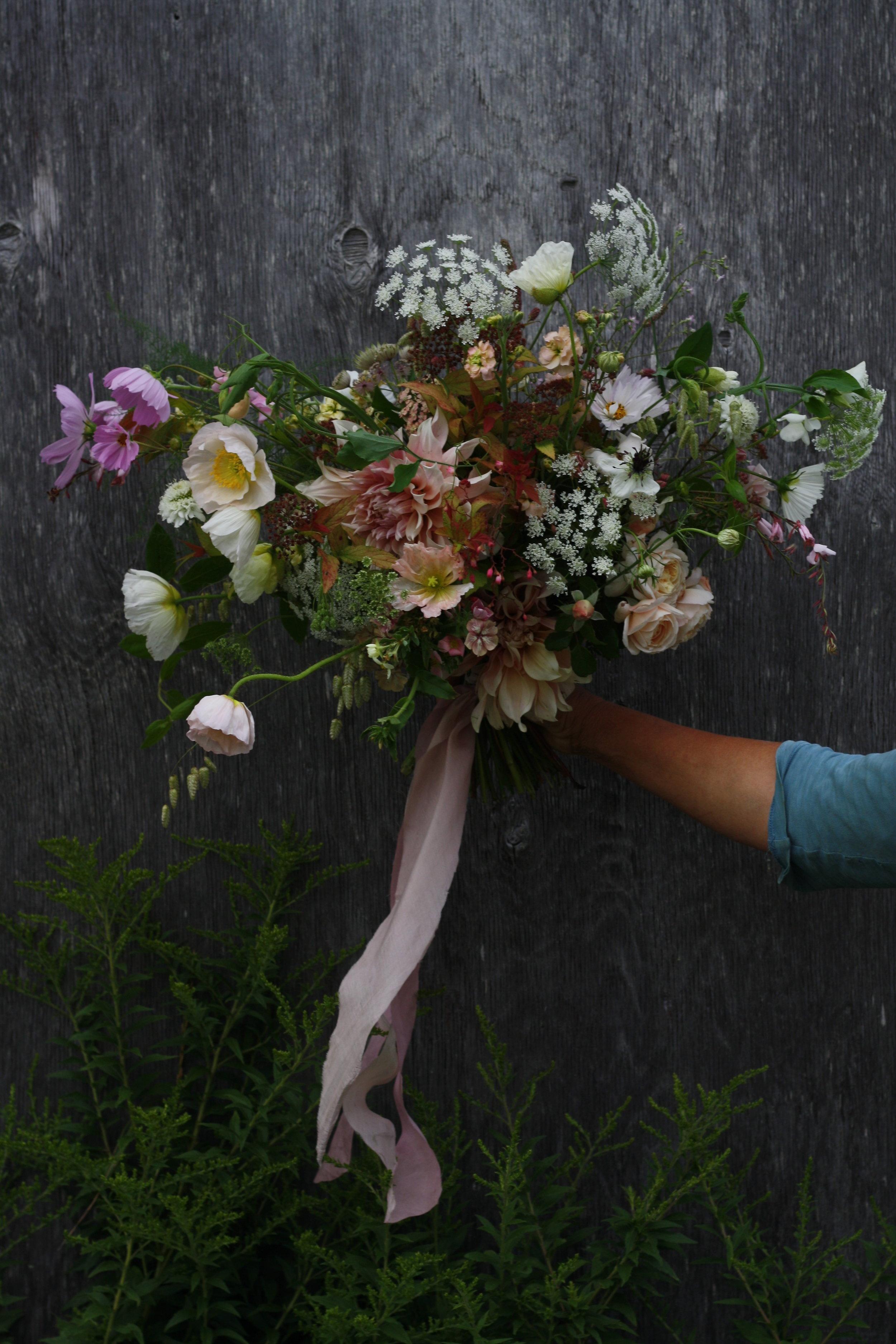 Bridal bouquet featuring, Colibri iceland poppy 'Bianco', David Austin garden rose 'Crocus' and Cafe Au Lait' dahlia.