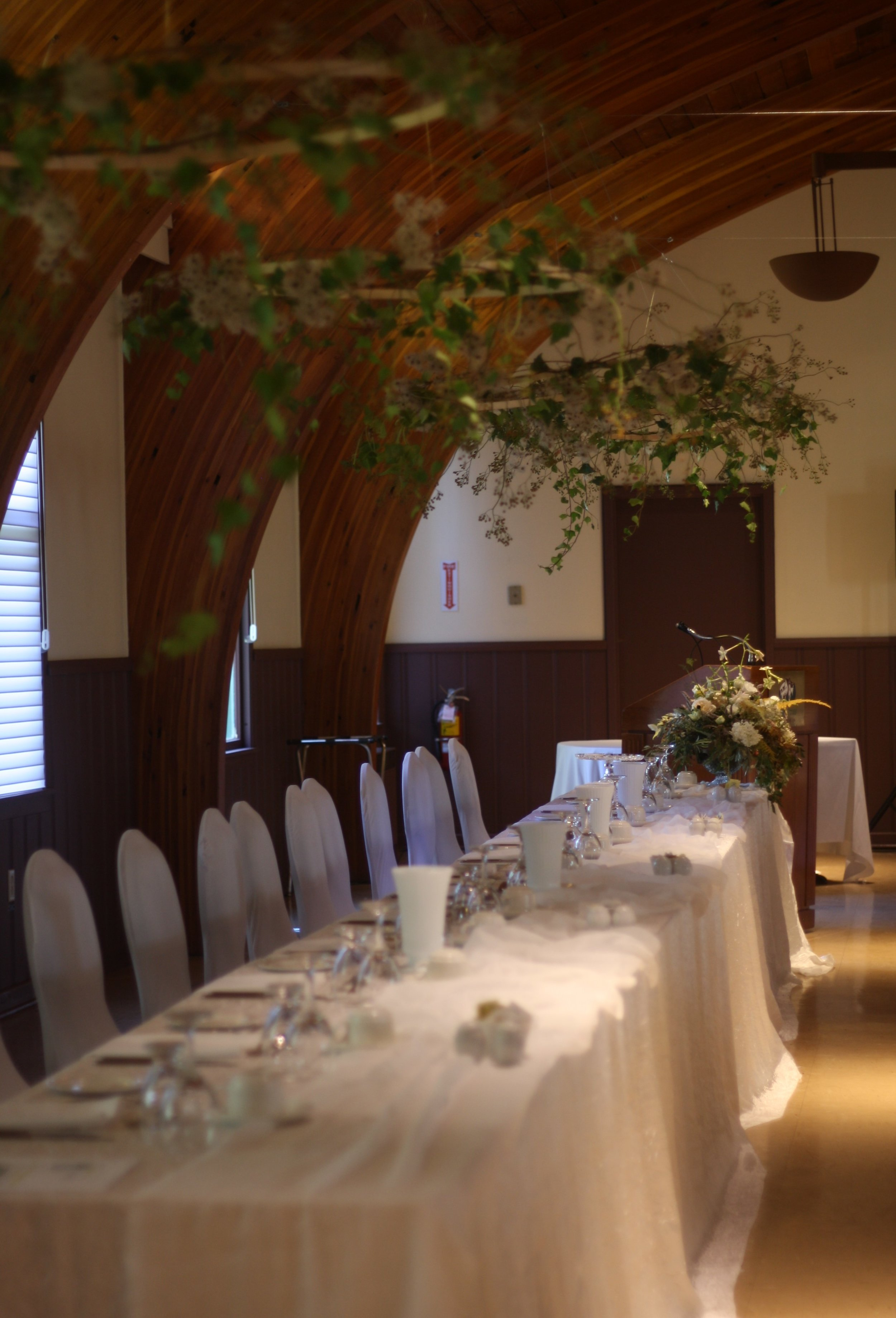 Greenery hoops floating above the head table. Digby Pines wedding, Nova Scotia