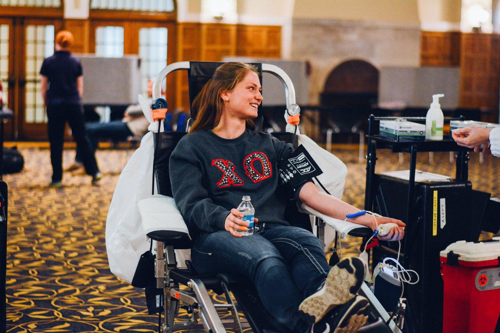 Junior Abby Renner donates blood during Greek Week. Photo by Melissa Quaiyoom