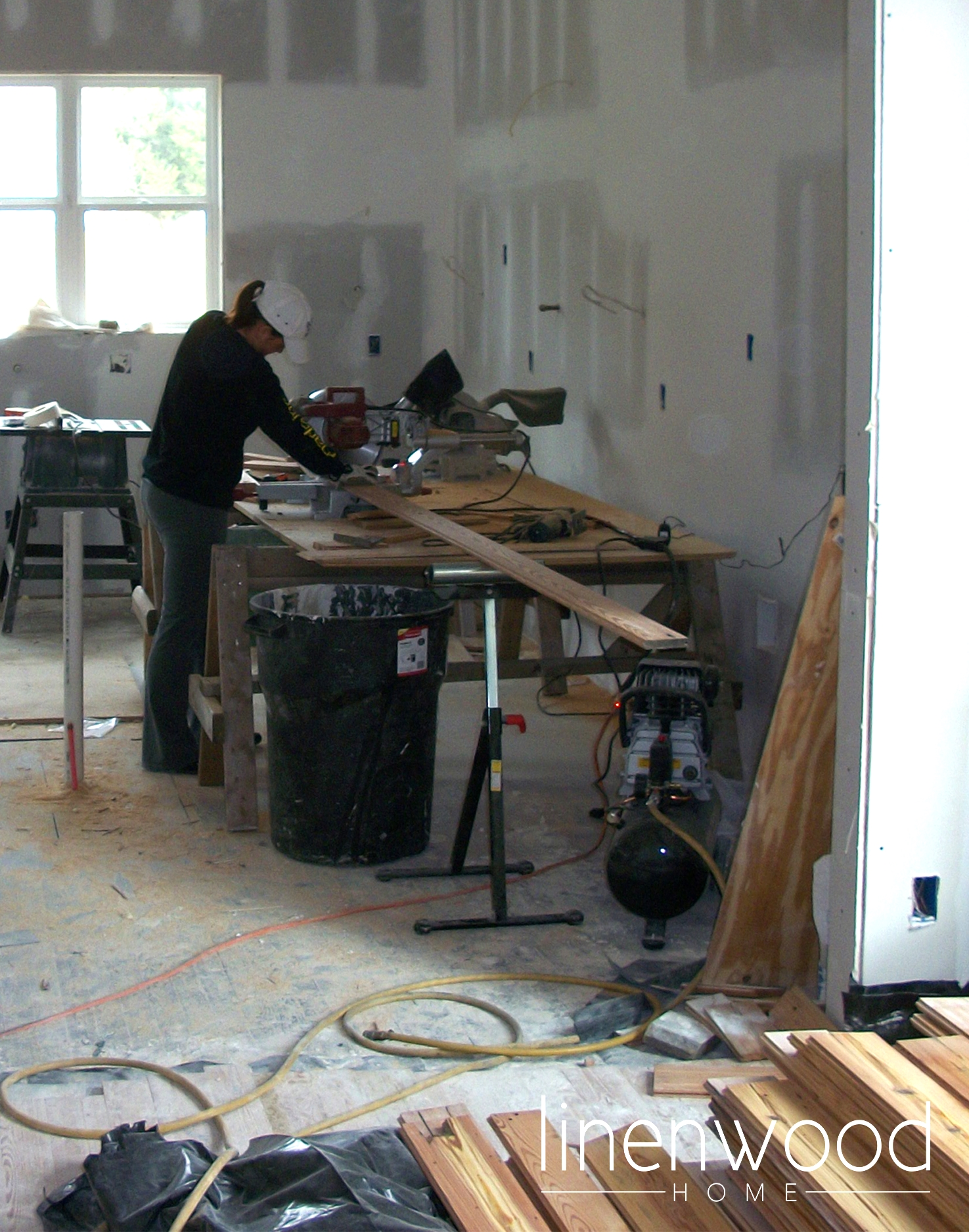 That's me, using the saw to cut the reclaimed hard wood floors. Yep - I can use power tools!
