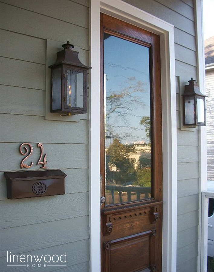The Brainerd Street House front entrance flanked with copper gas lanterns.