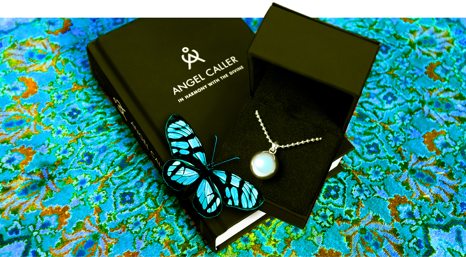 Spiritual_Alignment-Angel_Caller_Chime_Ball_Necklace_And_Book.jpg