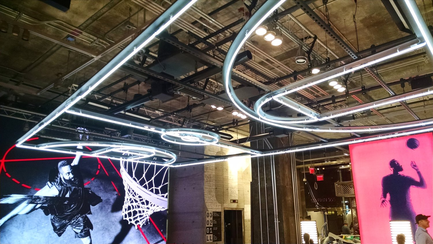 Directional subwoofers contain audio to a broad zone at the Adidas flagship store in New York City.