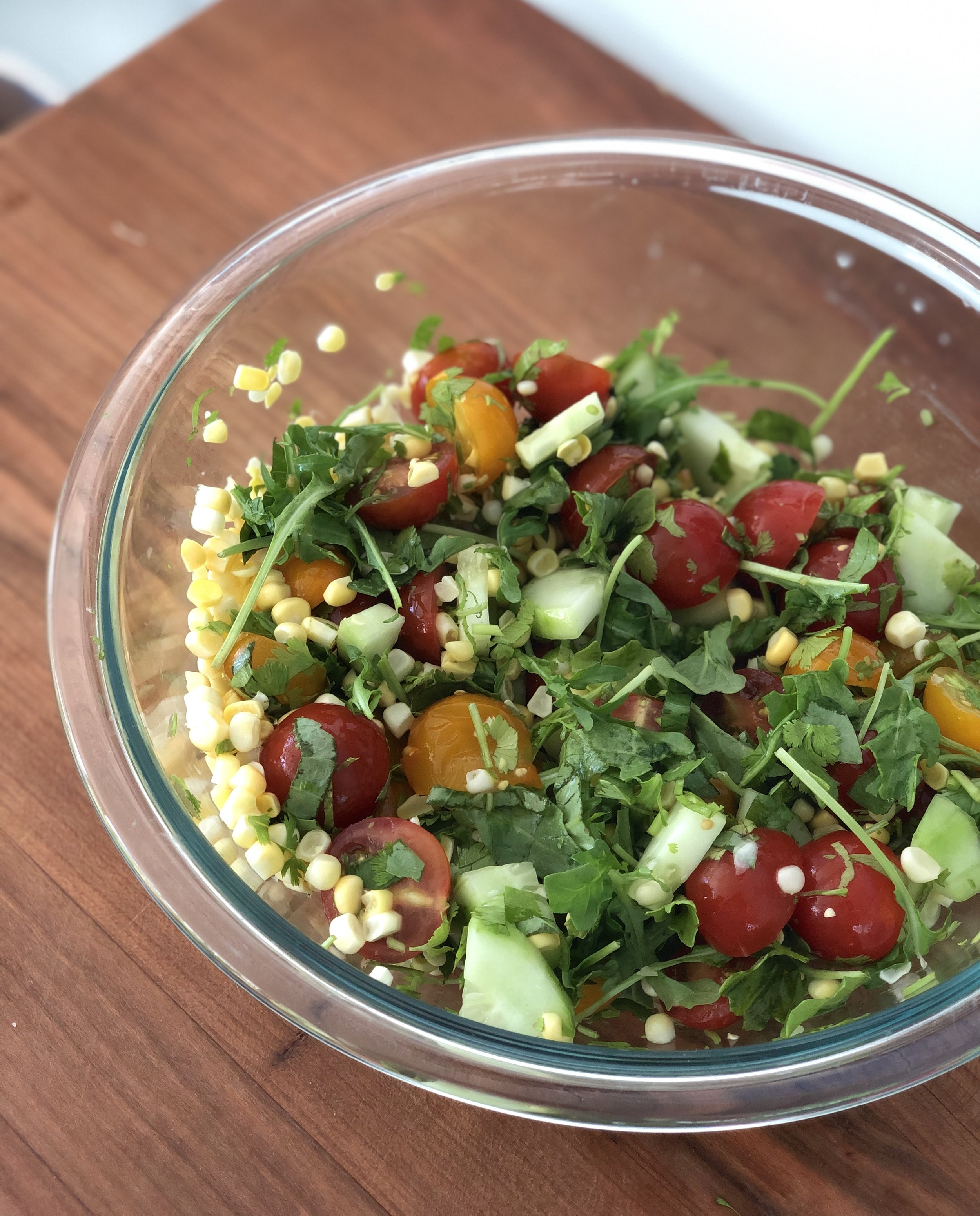 This simple salad paired perfectly with the flaky fish and could be adjusted depending on the season! The peppery punch from the arugula, sweetness of the corn and tomato and the fresh crunch of the cucumber were oh so delicious.