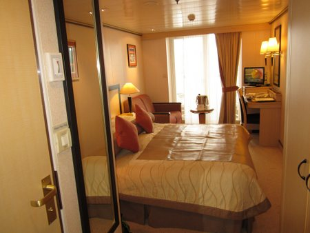 My stateroom on the Queen Mary 2 05/17/11 crossing from NYC to Southampton. The champagne bottle sits in a bucket of melting ice.