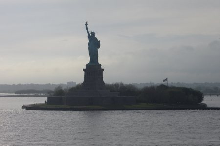 The Statue of Liberty viewed from the balcony of my stateroom on the Queen Mary 2 as we leave port in Manhattan.