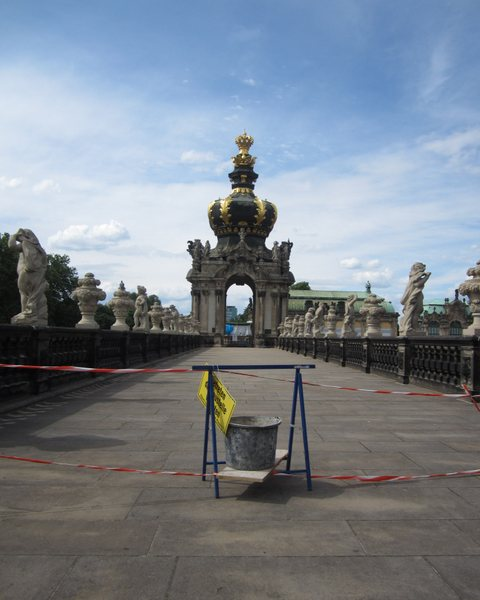 Construction on the top of one of the walls of the Zwinger Palace, Dresden, Germany.