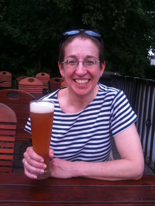 Me drinking my first fresh German beer at a biergarten in Dresden, Germany, May 2011. If I remember correctly, it was a hefeweizen. Thanks to Lisa Larsen for the photo.