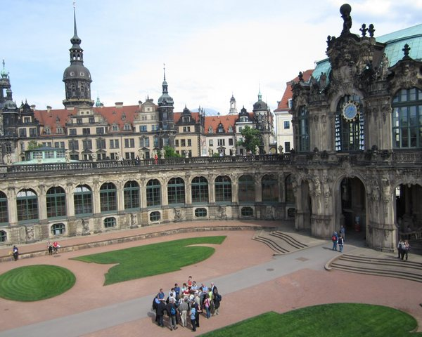 The Zwinger palace, the main palace of Augustus the Strong, built in the 18th century. A tour group convenes below me as I stand on the walkway above. Dresden, Germany, May 2011.